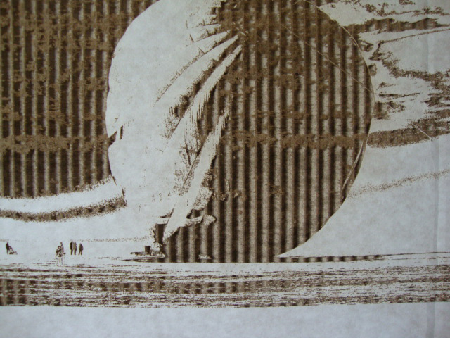 Balloon etched onto white corrugated card