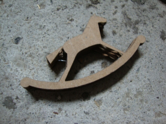 layers of laser cut rocking horses glued together